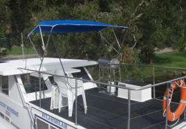 The 33ft houseboat has a Sun deck with a table, chairs and a BBQ