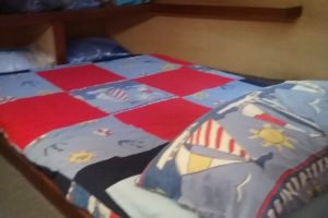 On the 33ft houseboat, we make the bed with all the linen.